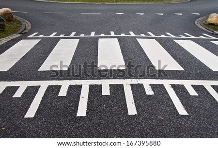 Zebra crossing on a speed bump sideways - stock photo