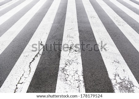 Zebra crossing painted on the asphalt, detail of a signal circulation, traffic information for pedestrians and drivers, security - stock photo