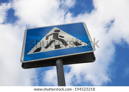 zebra crossing sign with blue sky background - stock photo