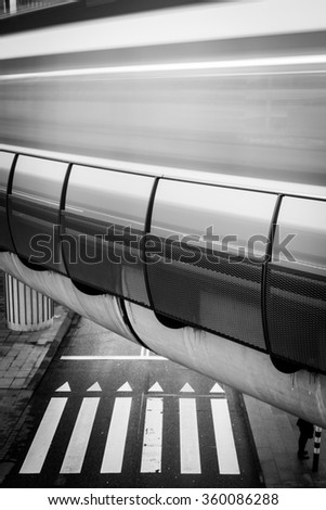 Zebra crossing under a moving tram  - stock photo