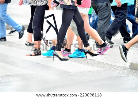 Zebra crossing with people in motion - stock photo