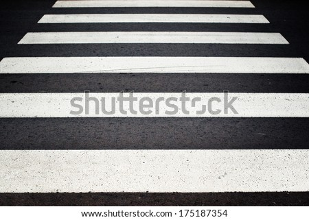 Zebra pedestrian crossing as urban background image. - stock photo