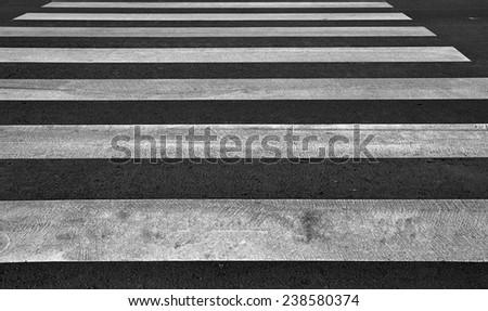 Zebra pedestrian crossing as urban background image. - stock photo