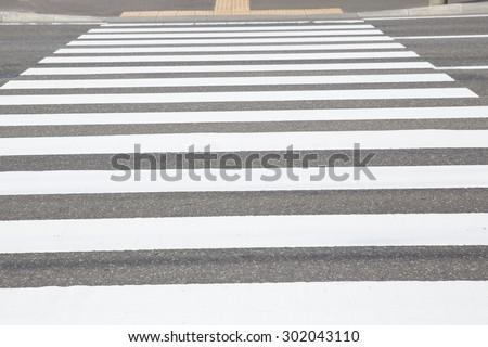 Zebra traffic walk way in the city - stock photo
