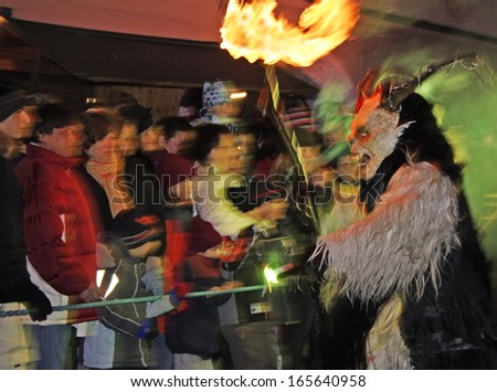 ZELL AM SEE, AUSTRIA - DECEMBER 5: Unidentified man wears Krampus (devil) mask at traditional procession on December 5, 2006 in Zell am See.