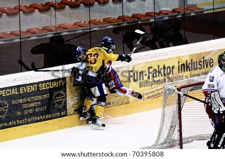 ZELL AM SEE, AUSTRIA - FEB 1: Austrian National League. Phillipp Ullrich hits Graz player. Game EK Zell am See vs. ATSE Graz (Result 4-1) on February 1, 2011, at hockey rink of Zell am See - stock photo