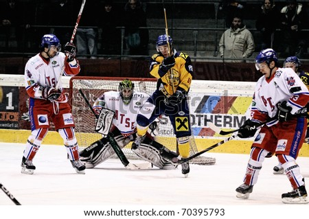 ZELL AM SEE, AUSTRIA - FEB 1: Austrian National League. Shot on Graz Keeper Ales Sila. Game EK Zell am See vs. ATSE Graz (Result 4-1) on February 1, 2011, at hockey rink of Zell am See - stock photo