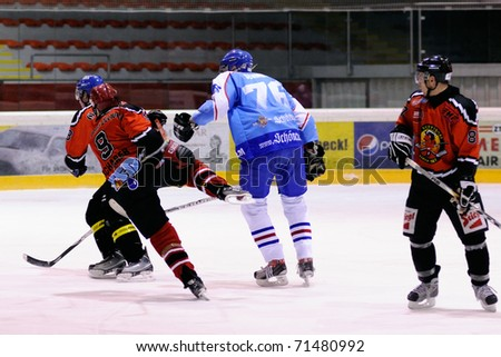 ZELL AM SEE, AUSTRIA - FEB 13: Salzburg hockey League. Hard hit against Scharer. Game SV Schuttdorf vs HCS Morzg  (Result 9-3) on February 13, 2011 at the hockey rink of Zell am See - stock photo
