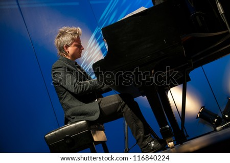 ZELL AM SEE, AUSTRIA - JUL 29: Balazs Havasi, the world fastest pianist in an exclusive concert in front of few people in Ferry Porsche Congress Centre, Zell am See, Austria on July 29, 2011. - stock photo