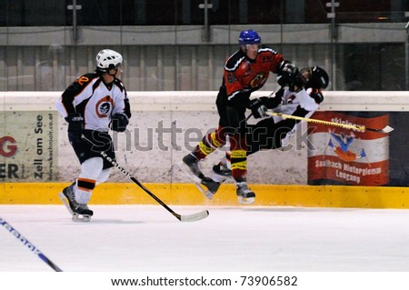 ZELL AM SEE, AUSTRIA - MARCH 19: Salzburg hockey League. Leitgob nails Salzburg player Game SV Schuettdorf vs Salzburg Sued  (Result 10-4) on March 19, 2011, at the hockey rink of Zell am See.