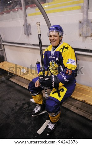 ZELL AM SEE; AUSTRIA - OCT 2: Austrian National League. D'Ambros Gunther number 13 of EKZ got 2 minutes for hooking. EK Zell am See vs ATSE Graz (Result 2-3) on October 2, 2011 in Zell am See - stock photo