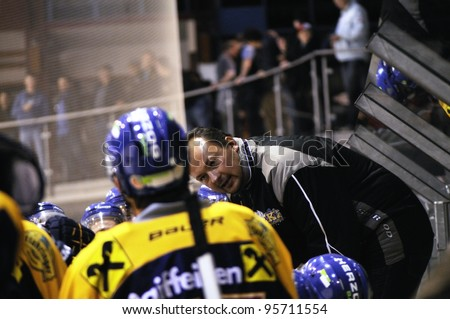 ZELL AM SEE; AUSTRIA - OCT 01: Austrian National League. Milan Manzanec trainer of EKZ tells his players to be focused. EK Zell am See vs Linz II (Result 5-2) on October 01, 2011 in Zell am See. - stock photo