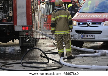 ZELL AM SEE; AUSTRIA - OCT 31: Firefighters attempt to extinguish a big fire in the centre of Zell am See on October 31, 2011 in Zell am See.