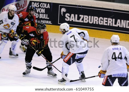 ZELL AM SEE, AUSTRIA - SEPTEMBER 3: Red Bulls Salute Tournament. Antti-Jussi Niemi (7) batteling with Christian Dub?. Game Jokerit Helsinki vs. SC Bern (Result 0-2) on September 3, 2010 in Zell am See - stock photo