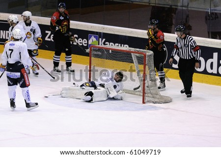 ZELL AM SEE, AUSTRIA - SEPTEMBER 3: Red Bulls Salute Tournament. Jokerit Goalie Mika Jaervinen injured. Game Jokerit Helsinki vs. SC Bern (Result 0-2) on September 3, 2010 in Zell am See - stock photo