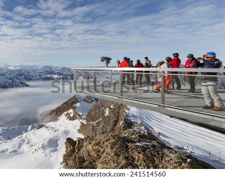 Zell am See - December 6, 2014: A lot of people admire the scenery and take pictures on the viewing platform at a height of 3000 m on the glacier of 6 December 2014, Zell am See, Kaprun, Austria - stock photo