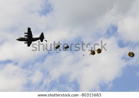 ZELTWEG, AUSTRIA - JULY 01: paratroops and Herkules C130 of the Austrian army by airshow - airpower11 - on July 01, 2011 in Zeltweg, Austria