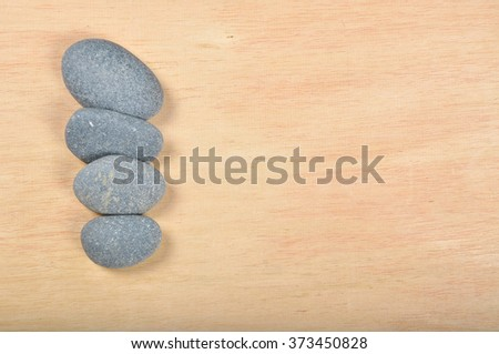 zen and spa stone on the plain wood with copy space area. - stock photo