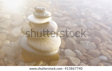 Zen Balancing Rocks on Pebbles covered with water. - stock photo