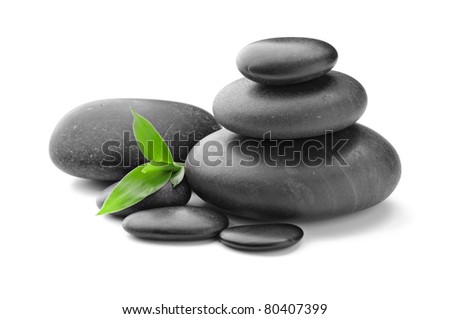 zen basalt stones and leaves - stock photo