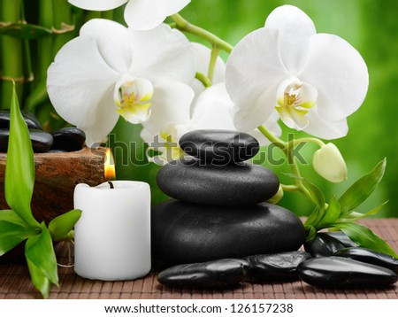 zen basalt stones and orchid on the wood - stock photo