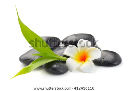 zen basalt stones ,frangipani and bamboo isolated on white - stock photo