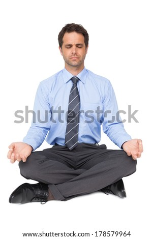 Zen businessman meditating in yoga pose on white background - stock photo