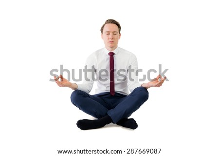 Zen businessman meditating in yoga pose on white background