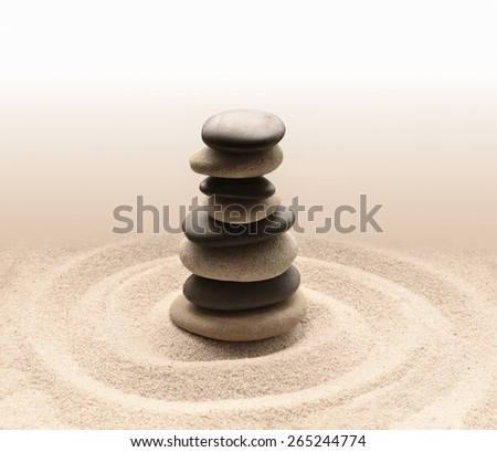 Zen garden meditation stone for concentration and relaxation sand and rock for harmony and balance - stock photo