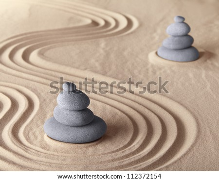 zen garden meditation stone for meditation and relaxation conceptual for simplicity harmony purity and balance background with copy space - stock photo