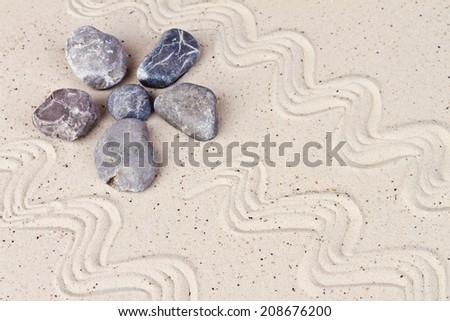 Zen garden with sand stones - stock photo