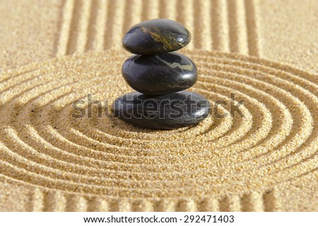 ZEN garden with stacked stones in sand