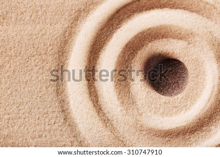 Zen garden with stone for relaxation - stock photo