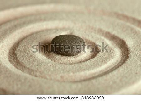 Zen garden with stone on sand background - stock photo