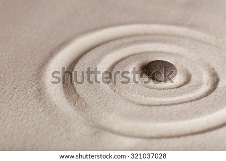 Zen garden with stone on sand background - stock photo