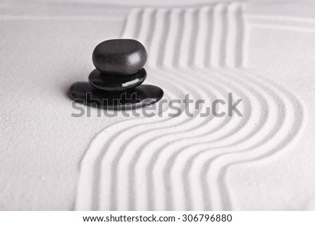 Zen garden with stones on sand background - stock photo