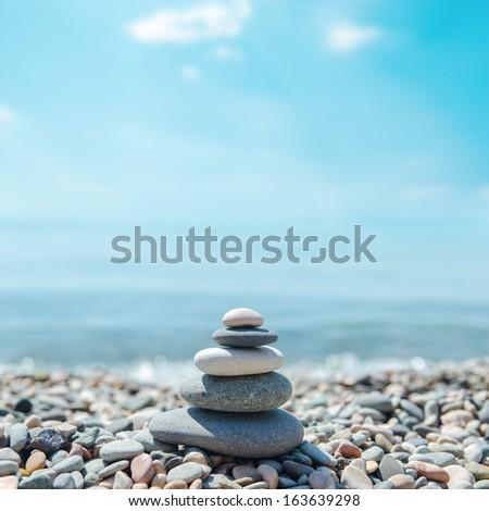 zen-like stones on beach - stock photo