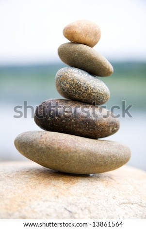 Zen like stones stack on the big stone