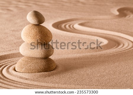 zen meditation garden stack of stones, relaxation and meditation through simplicity harmony and rock balance lead to health and wellness, balancing and concentration background with copy space - stock photo
