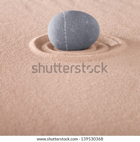 zen meditation stone on circle in sand. Japanese sand garden with round rock concept for purity and spa wellness tranquility and spirituality - stock photo