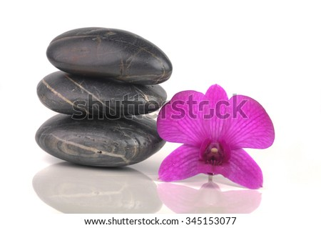 Zen pebbles and Orchid for Spa and healthcare concept.