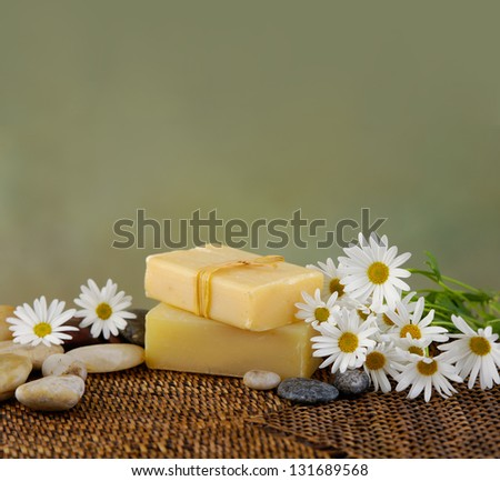 Zen rock and soap , daisy on mat