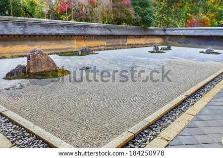 Zen Rock Garden in Ryoanji Temple in Kyoto  - stock photo