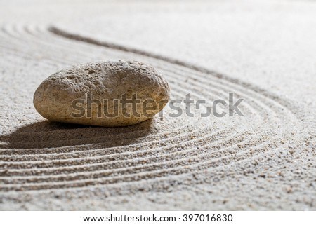 zen sand still-life - textured stone on sinuous waves for concept of beauty spa or wellness with inner peace, closeup - stock photo
