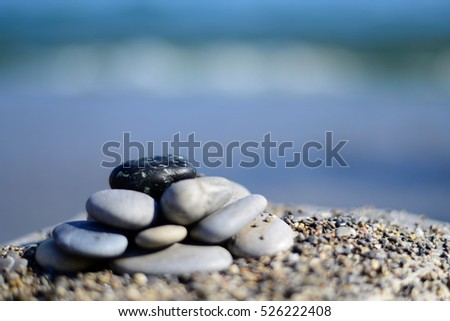 Zen spa stones with blue water and sky. Background with copy space. Spa symbol. Beautiful picture. Group of stones on the beach. Tranquil, relaxation and health life. Stones spa.