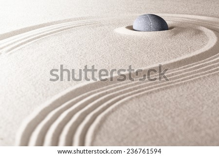 zen stone and sand garden. Concept for relaxation meditation purity spirituality and balance. Rock and lines spa wellness background - stock photo