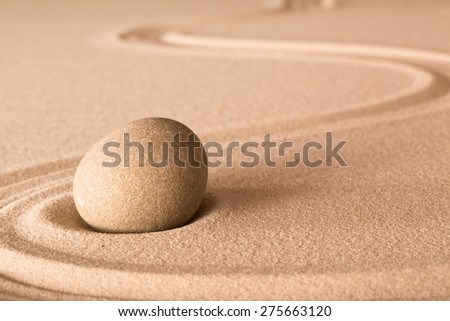 zen stone and sand in Japanese meditation garden. Spa wellness background for balance and spirituality.  - stock photo