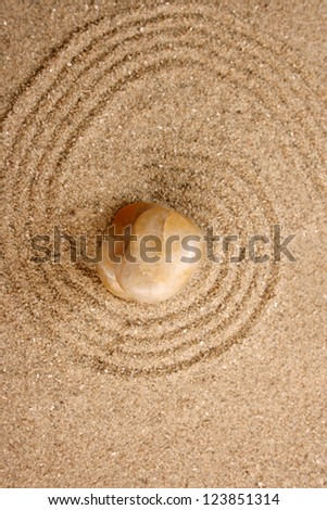 Zen stone in the sand - stock photo