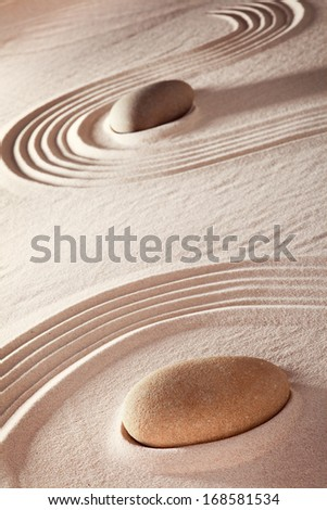 zen stone meditation garden a concentration of energy and harmony leading to purity and serenity. Spa wellness and relaxation background with sand and rocks. - stock photo