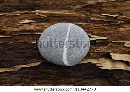 zen Stone on Driftwood texture - stock photo